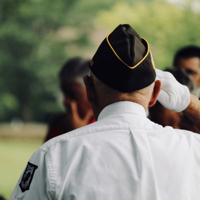 Image of Old man Veteran giving a salute