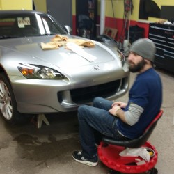 Technician in the middle of paint protection process