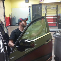 Installing window tinting on driver's side window