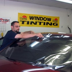 Placing window tinting on the windshield
