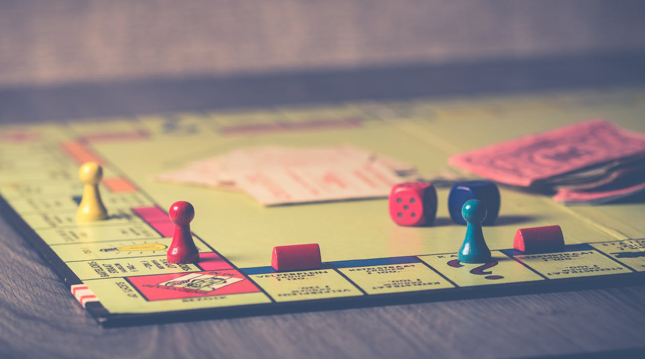 A monopoly board game with dice and game pieces