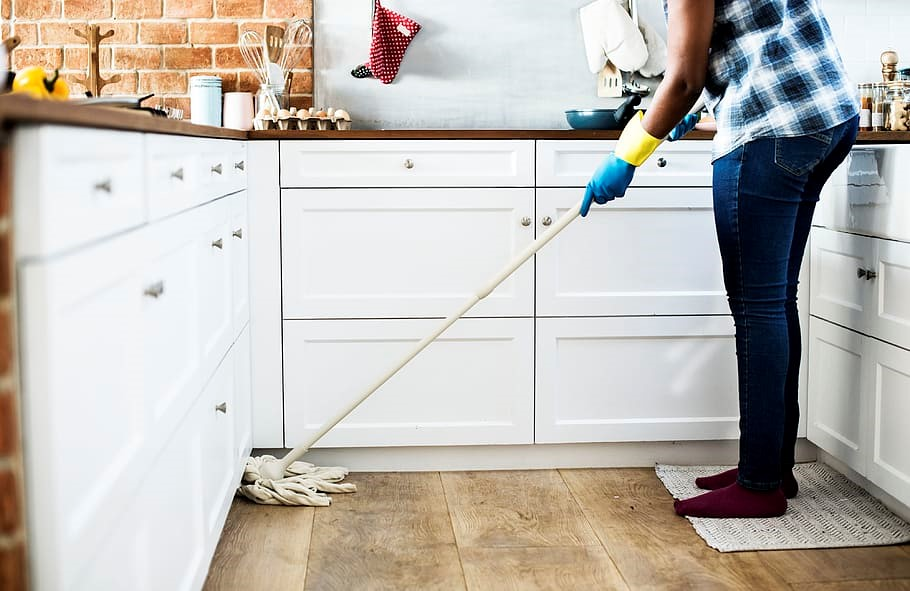 Person cleaning up in the kitchen.