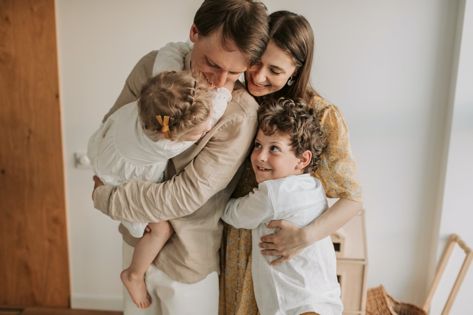 Photo of a happy family hugging each other.