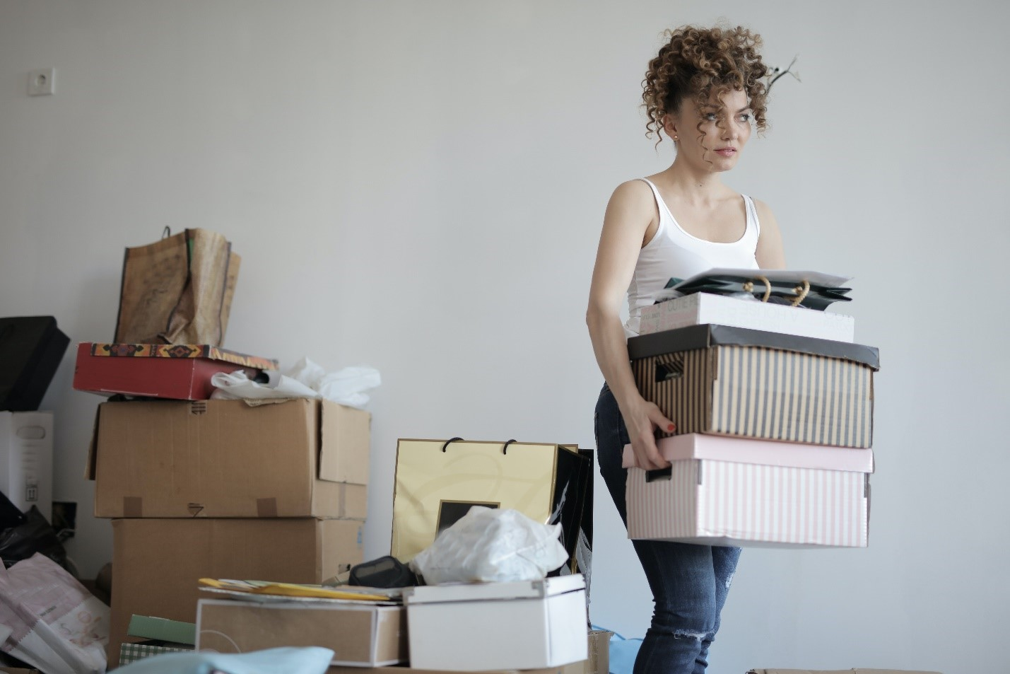 Woman moving multiple boxes