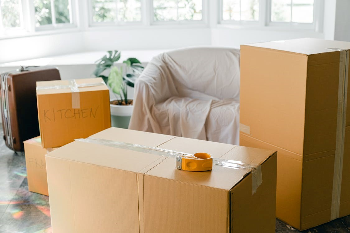 A room with packed cardboard boxes.