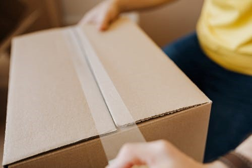 Professional movers service taping the boxes for a move in Seattle
