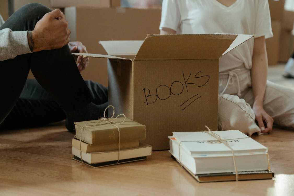 Unpacking a box labeled with 'Books.'