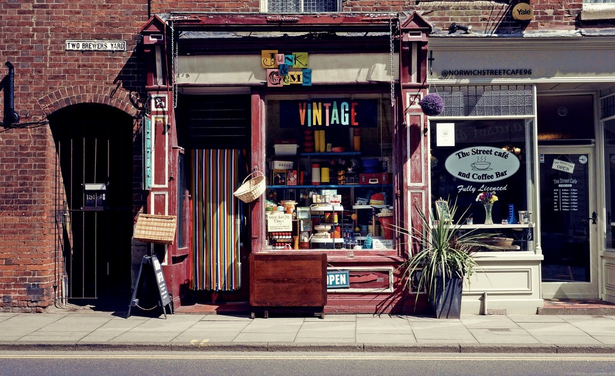 A café and a vintage store in a city