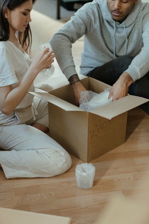 Professional movers service helping you carefully wrapping fragile items in Seattle.