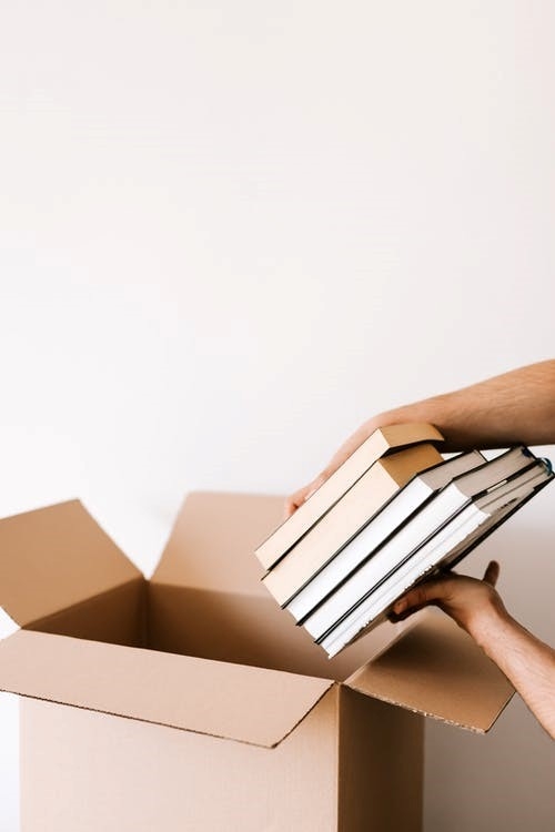 Professional movers service packing heavy items in Seattle.