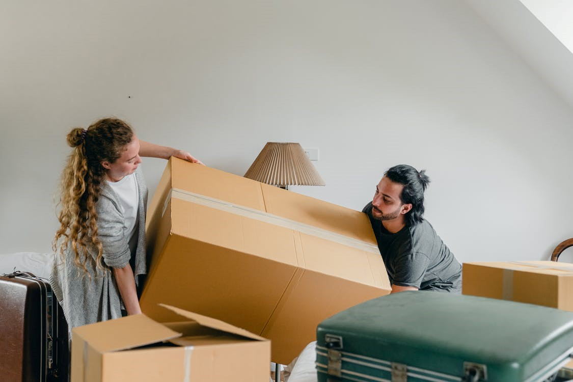 Professional movers service helping a family pack in Seattle.