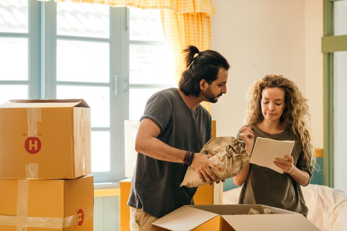 A couple unpacking their boxes in Seattle.