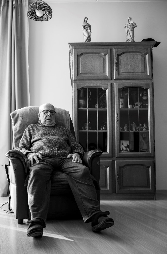 An older man relaxing in his favorite chair.