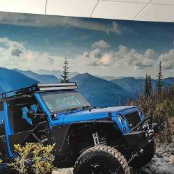 Commercial interior wall with graphic design of Jeep on a mountain - Action Signs