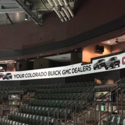 Large commercial banner hanging in an arena - Action Signs