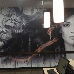 Business interior with printed mural of girl and flowing hair - Action Signs