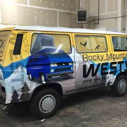 Custom vehicle wrap on a commercial van - Action Signs