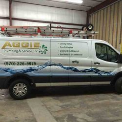 Side of a commercial van with custom vehicle wrap - Action Signs