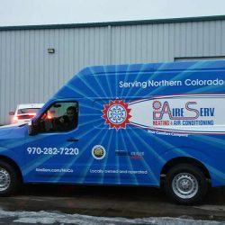 Commercial van with a custom vehicle wrap - Action Signs