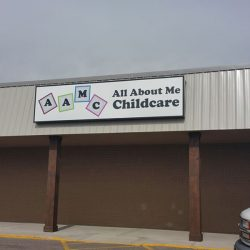 Exterior business sign for All About Me Childcare - Action Signs