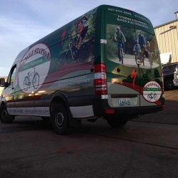 Professional van wrap with business logo and information - Action Signs