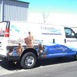 Business van with a vehicle wrap design - Action Signs
