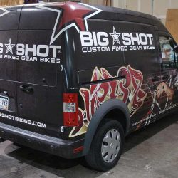 Commercial van with a vehicle wrap - Action Signs