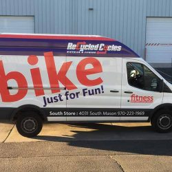 Vehicle wrap on a van with business information - Action Signs