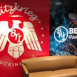 Interior wall with business graphics - Action Signs