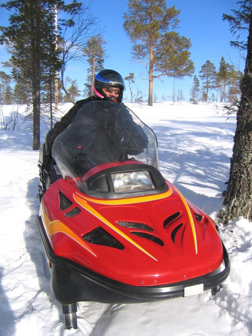 Red snowmobile with orange decals