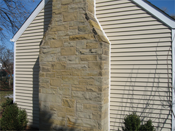 Vinyle Siding on a home with a chimney block.