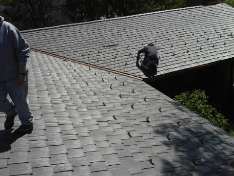 Roofers performing a roof repair in Lisle, IL.