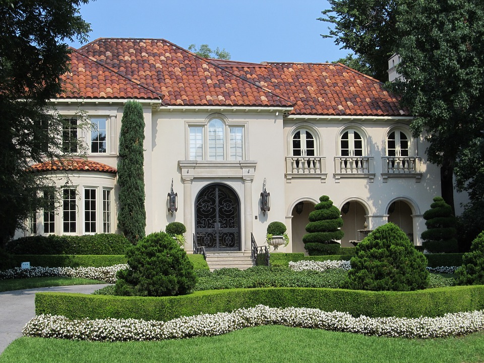 A big two story home, with beautiful tile shingles.