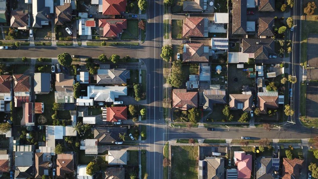 An overhead view of composite roofs in a neighborhood.