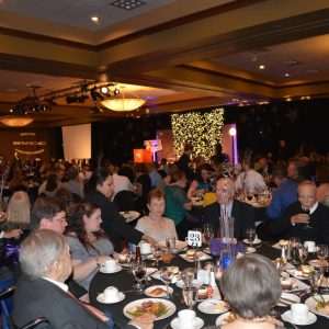 People enjoying dinner at the Night of Stars Gala fundraiser