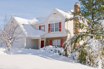 suburban house covered in heavy snow