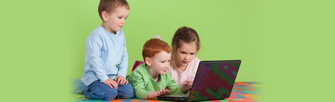 Child Care Center-Children with Laptop-Adventures In Learning