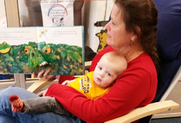 Child Care Center-Story Time with Infant-Adventures in Learning