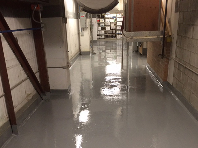 Hall with epoxy floor coating by Aetna Integrated Services