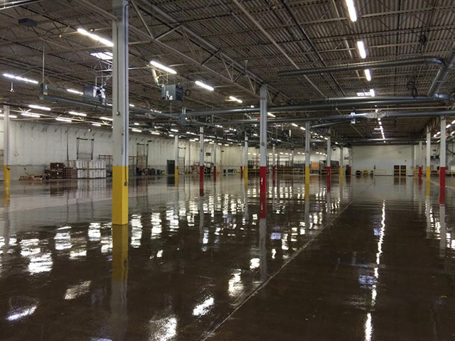 Aetna Integrated Services epoxy floors in a large industrial facility