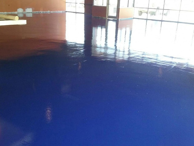 Blue industrial epoxy floor coating by Aetna Integrated Services