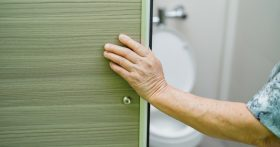 Image of Person Opening Bathroom Door To Toilet
