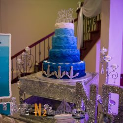 Blue cake and sign at our reception hall - Alegria Gardens