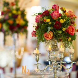 Flower arrangement with candelabra at our wedding venue - Alegria Gardens