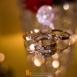 A picture of three intricate rings taken on a glass surface at Alegria Gardens Reception Hall in Houston.