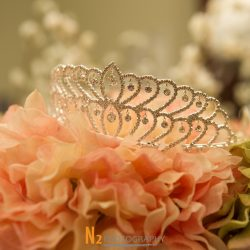 A photograph of a beautifully decorated tiara crown taken before a quinceañera at Alegria Gardens Reception Hall in Houston.