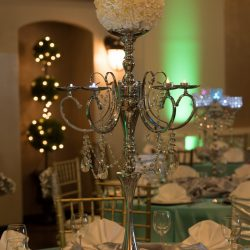 Metal flower bouquet on top of a dining table for a wedding reception at Alegria Gardens Reception Hall in Houston.