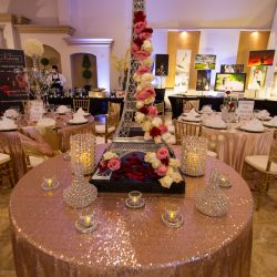 A close-up shot of a table decorated with rose petals at Alegria Gardens Reception Hall in Houston.