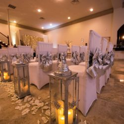 Beautifully decorated chairs for a wedding ceremony taken at Alegria Gardens Reception Hall in Houston.