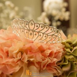 Elegant tiara with pink flowers at our reception hall - Alegria Gardens